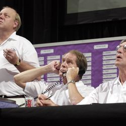 Larry Miller, Kevin O'Connor, and Jerry Sloan watch the first-round picks duringan NBA draft party at the Delta Center.