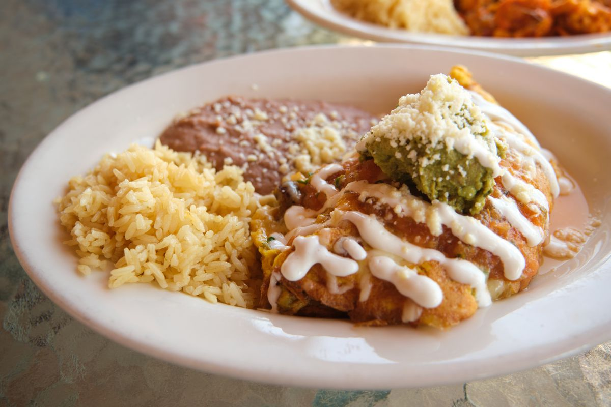 a plate of food with beans and rice.