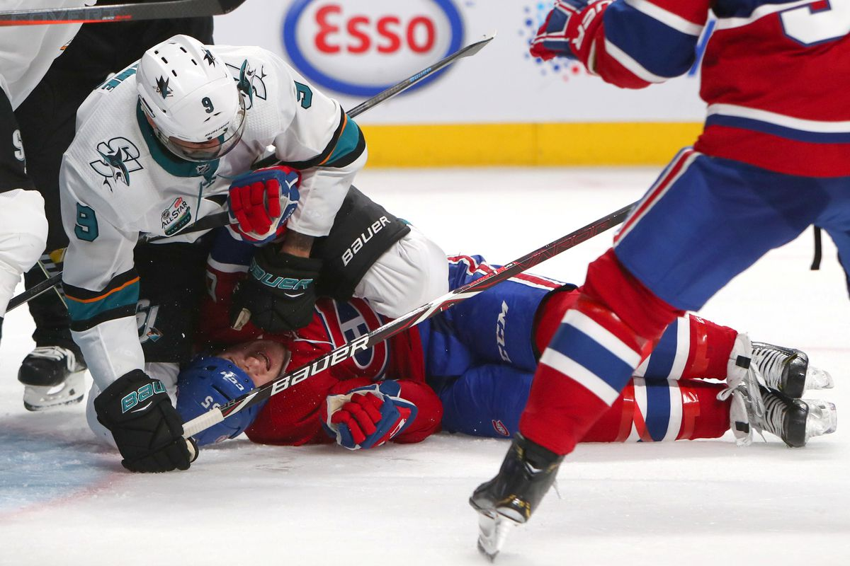 Dec 2, 2018; Montreal, Quebec, CAN; San Jose Sharks left wing Evander Kane (9) and Montreal Canadiens right wing Andrew Shaw (65) exchange blows during the third period at Bell Centre.