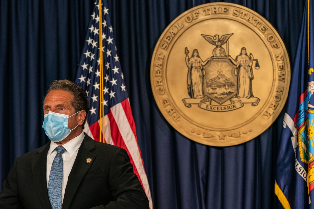 Gov. Andrew Cuomo wears a mask while holding a briefing in New York