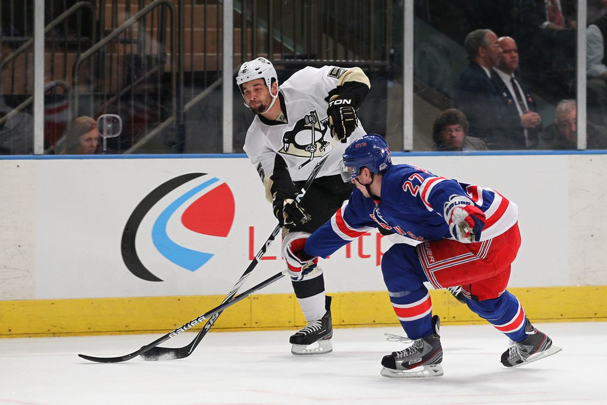 NEW YORK, NY - JANUARY 19:  Deryk Engelland #5 of the Pittsburgh Penguins shoots against Ryan McDonagh #27 of the New York Rangers during their game on January 19, 2012 at Madison Square Garden in New York City.  (Photo by Al Bello/Getty Images)