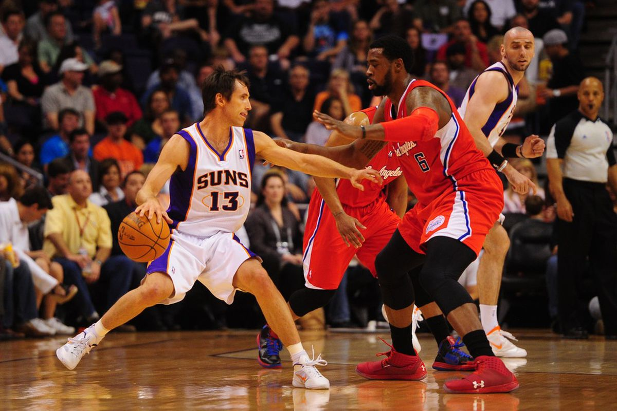 Apr. 19, 2012; Phoenix, AZ, USA; Phoenix Suns guard (13) Steve Nash controls the ball against Los Angeles Clippers center (6) DeAndre Jordan at the US Airways Center. Mandatory Credit: Mark J. Rebilas-US PRESSWIRE