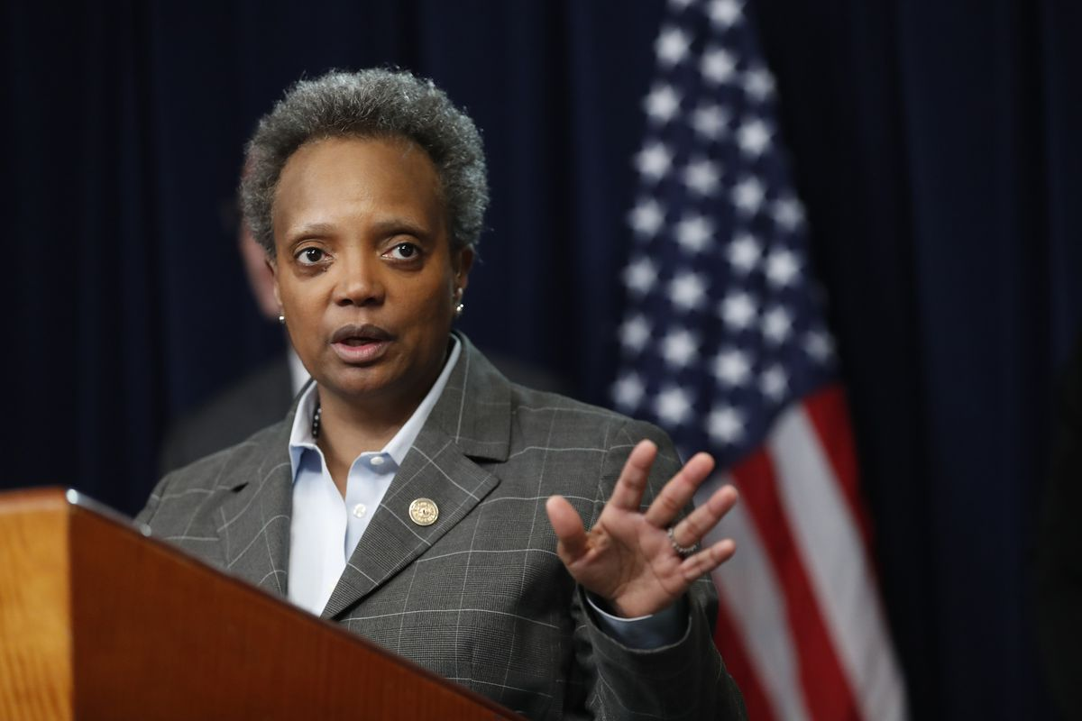 Mayor Lori Lightfoot responds to a question after Illinois Gov. J.B. Pritzker announced a shelter in place order to combat the spread of the Covid-19 virus, during a news conference Friday, March 20, 2020, in Chicago.