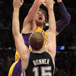 Los Angeles Lakers forward Pau Gasol of Spain goes for a shot as San Antonio Spurs forward Matt Bonner (15) defends during the first half of their NBA basketball game, Tuesday, April 17, 2012, in Los Angeles.