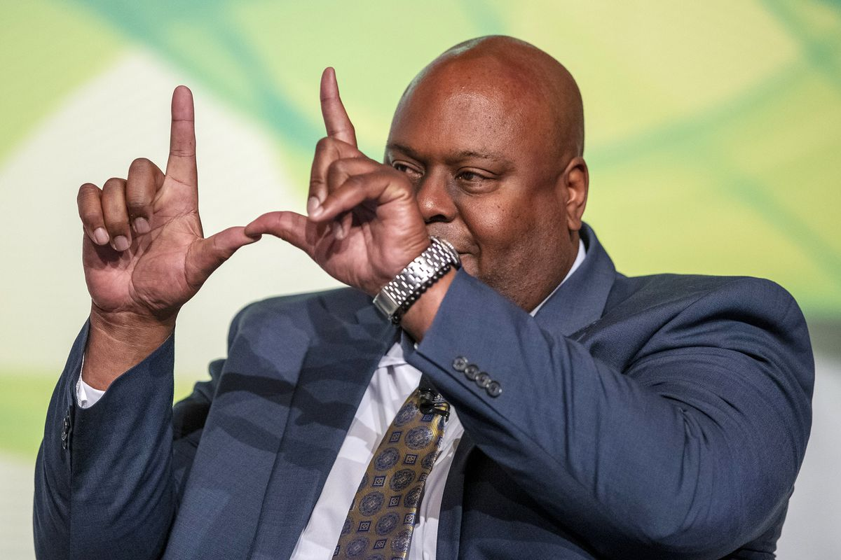 Former University of Utah and Chicago Bears football player Shawn Newell, vice president of business development at Industrial Supply Company, flashes his bock U at the 13th Utah Economic Summit at the Grand America Hote in Salt Lake City on Friday, May 17, 2019.