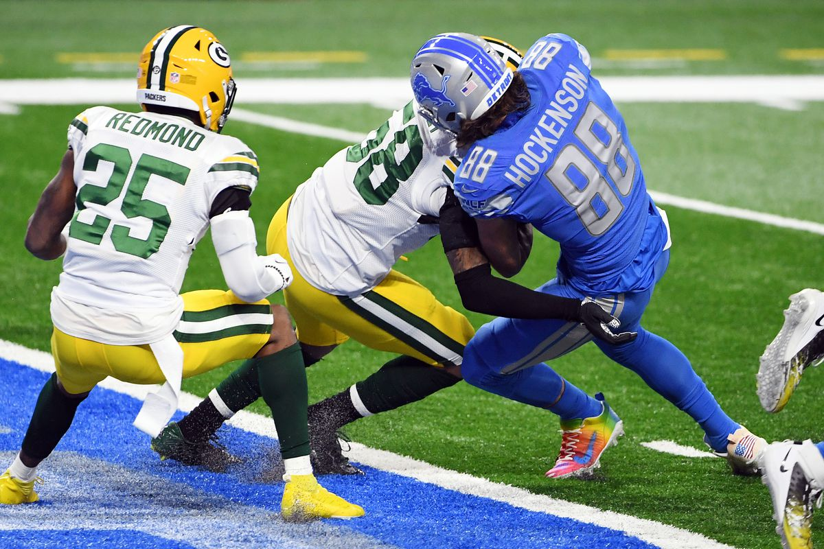 T.J. Hockenson #88 of the Detroit Lions scores a 1-yard receiving touchdown during the first quarter against the Green Bay Packers at Ford Field on December 13, 2020 in Detroit, Michigan.