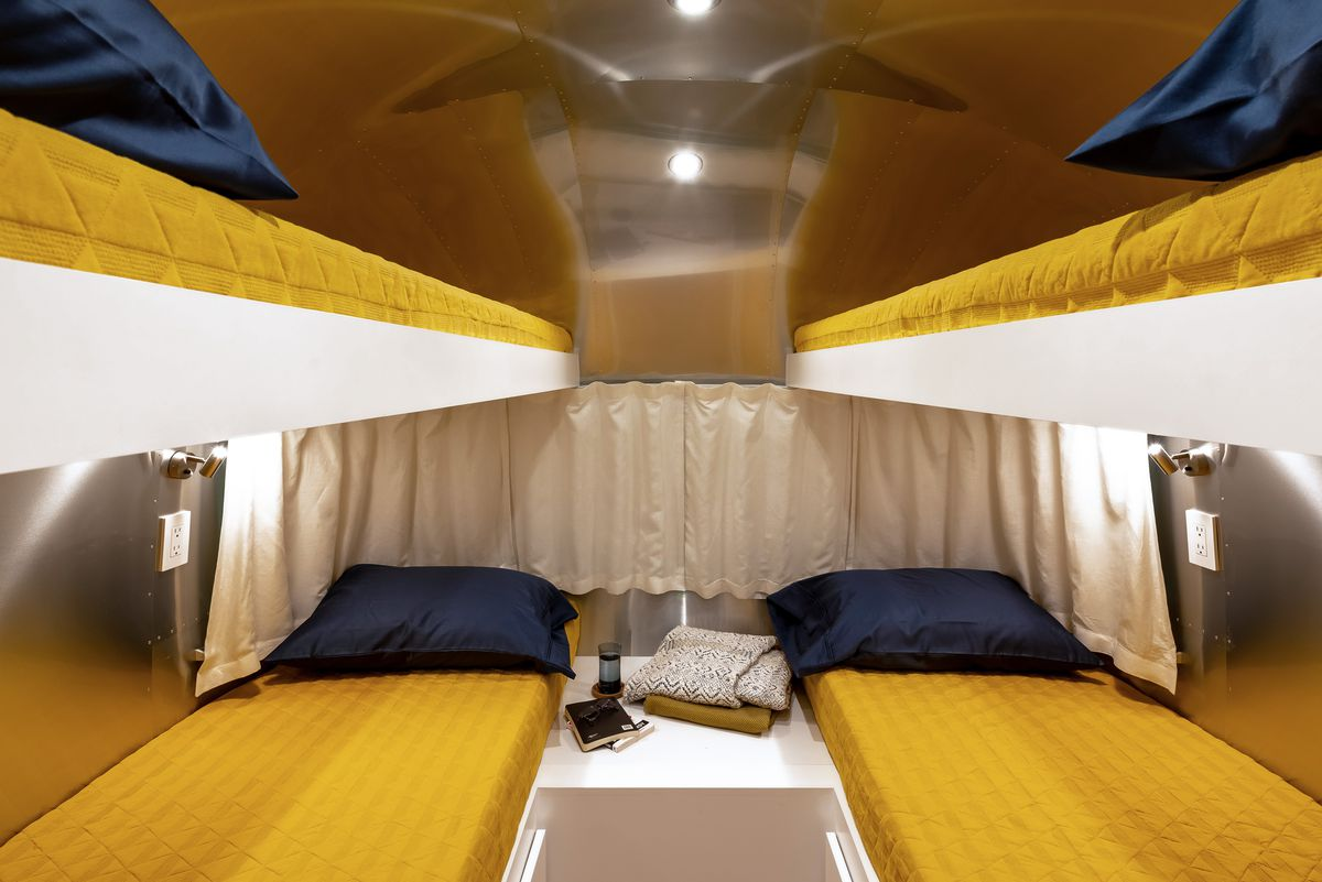 The rear of the trailer features bunk beds. The bottom bunk also transforms into a king size bed.