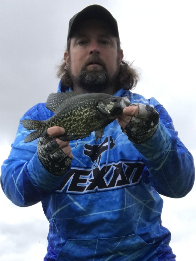 """Ken """"Husker"""" O'Malley with a dark crappie. Provided"""