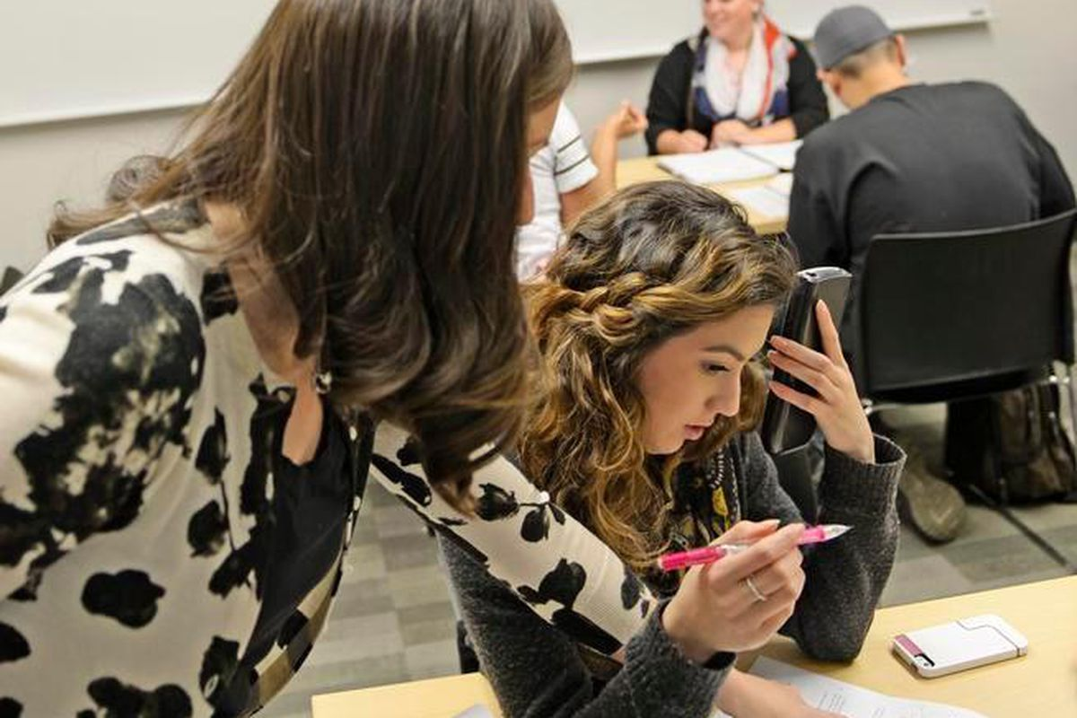 Math instructor Kellie Zolnikov, left, helps Kaitlin Carrasco, a student at Metro State University, during a math lab in 2014. Carrasco, 19, said she has always struggled in math, but scored high enough on her entrance exam to take the supplemental math lab she needs for a business management degree.