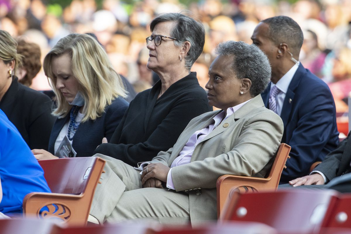 Mayor Lori Lightfoot and her wife Amy Eshleman take in the opening night of the 2021 Grant Park Music Festival at the Pritzker Pavilion on Friday night.