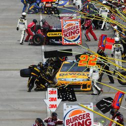 Drivers make pit stops during the NASCAR Sprint Cup Series auto race Sunday, April 1, 2012, in Martinsville, Va.