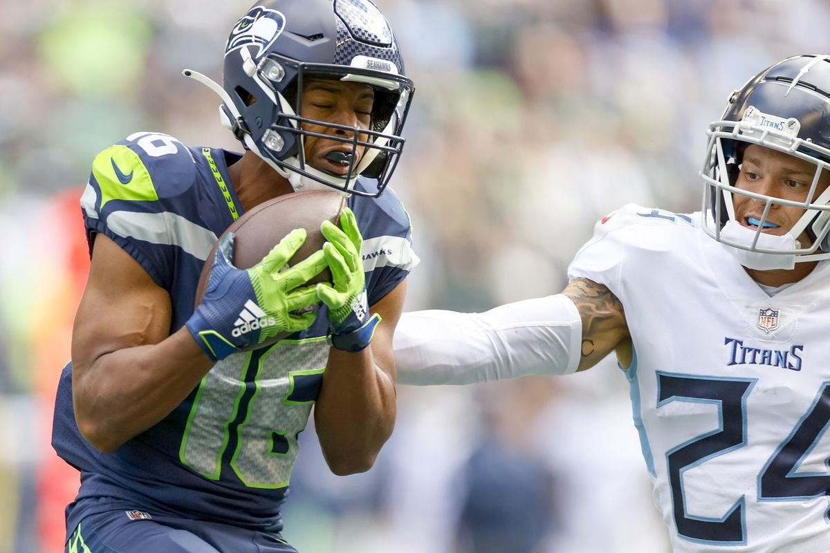 Tyler Lockett of the Seattle Seahawks makes a catch for a touchdown against the Tennessee Titans during the second quarter at Lumen Field on September 19, 2021 in Seattle, Washington.