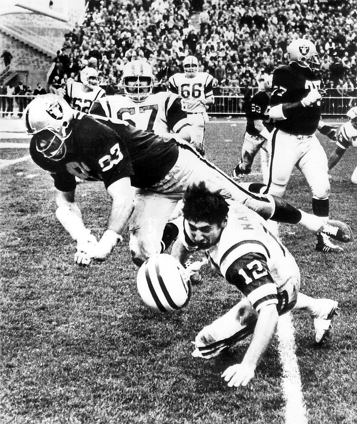OAKLAND, CA - DECEMBER 12, 1967: Oakland Raiders defensive end Ben Davidson delivers a blow to New York Jets quarterback Joe Namath during this game in 1967 won by the Raiders. (Russ Reed/Oakland Tribune/Staff Archives)