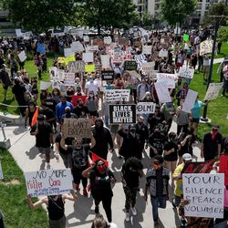 Protesters march through Library Square in Salt Lake City on Saturday, May 30, 2020 in the wake of the death of George Floyd, who died in police custody in Minneapolis.