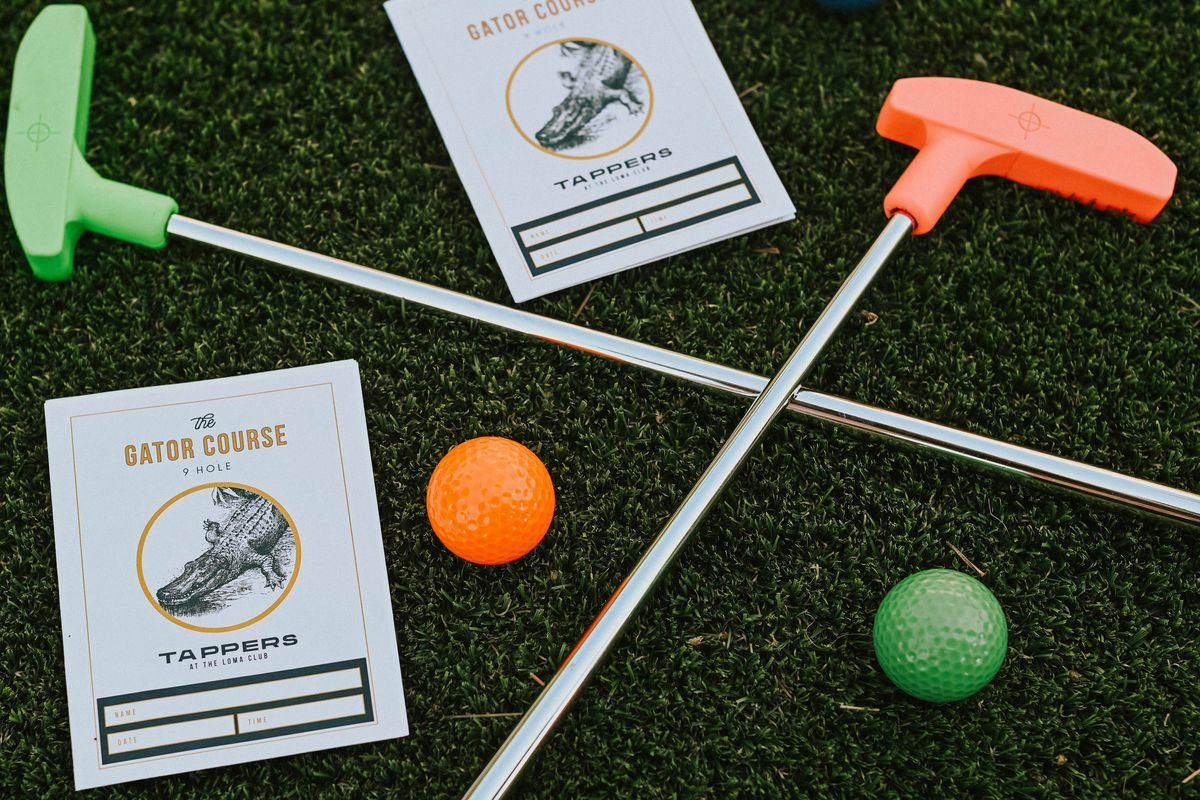 Layout of mini golf clubs and balls from Tappers Mini Golf
