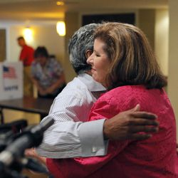 Karen Handel, right, Republican candidate for Congress, hugs the precinct manager, Neville Billy, who she has known for years from voting at this polling place,, at the 6th District Special Election at St Mary's Orthodox Church in Roswell, Ga. The matchup of Republican Handell and Democrat Jon Ossoff has become a proxy for the national political atmosphere and a test of GOP strength early in Donald Trump's presidency.