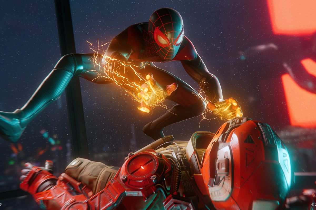 Spider-Man shocking an enemy lying on the ground in Spider-Man: Miles Morales