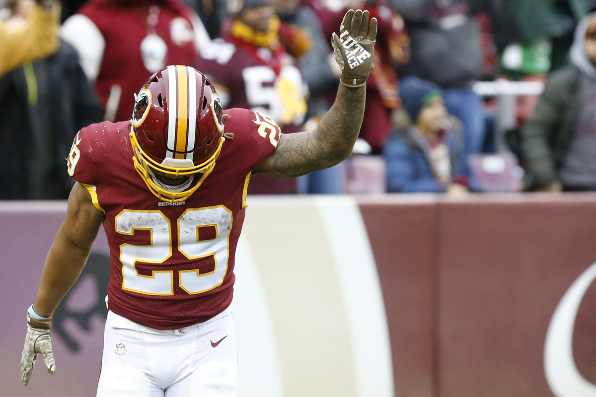 Washington Redskins running back Derrius Guice celebrates after scoring a touchdown against the New York Jets in the fourth quarter at FedExField.