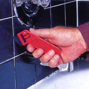<p>USE A GROUT saw to scratch out any cracked, softened or badly stained grout from the joints between the wall tiles.</p>