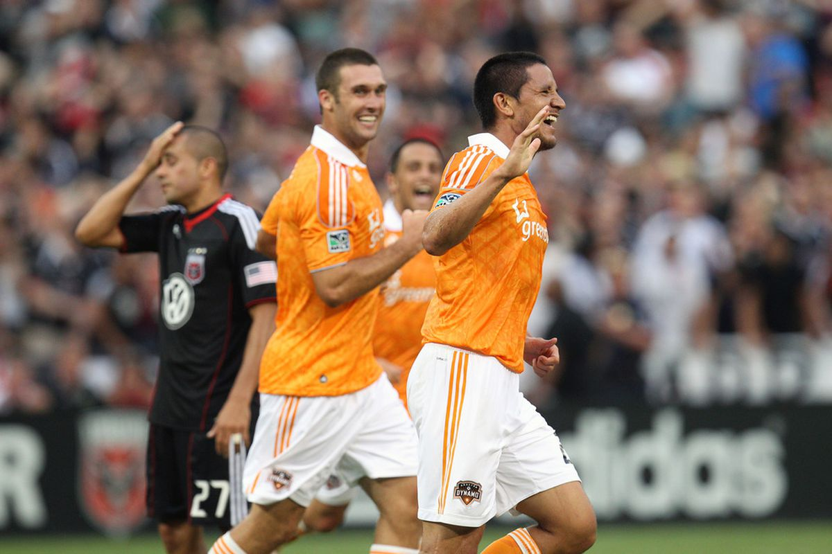 WASHINGTON, DC - JUNE 25: Brian Ching #25 of the Houston Dynamo celebrates a goal against D.C. United at RFK Stadium on June 25, 2011 in Washington, DC. (Photo by Ned Dishman/Getty Images)