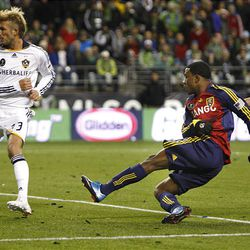 Real Salt Lake's Robbie Findley scored the team's only goal between L.A.'s David Beckham (left) and Stefani Miglioranzi.