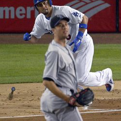 Los Angeles Dodgers' Shane Victorino, rear, and Colorado Rockies starting pitcher Jeff Francis watch Victorino's three-run home run during the second inning of a baseball game, Friday, Sept. 28, 2012, in Los Angeles.