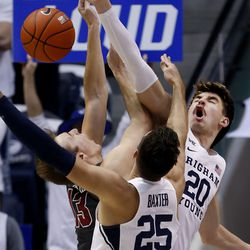 Santa Clara Broncos forward Josip Vrankic (13) gets blocked by Brigham Young Cougars forward Gavin Baxter (25) and Zac Seljaas (20) at Brigham Young University in Provo on Thursday, Feb. 20, 2020.