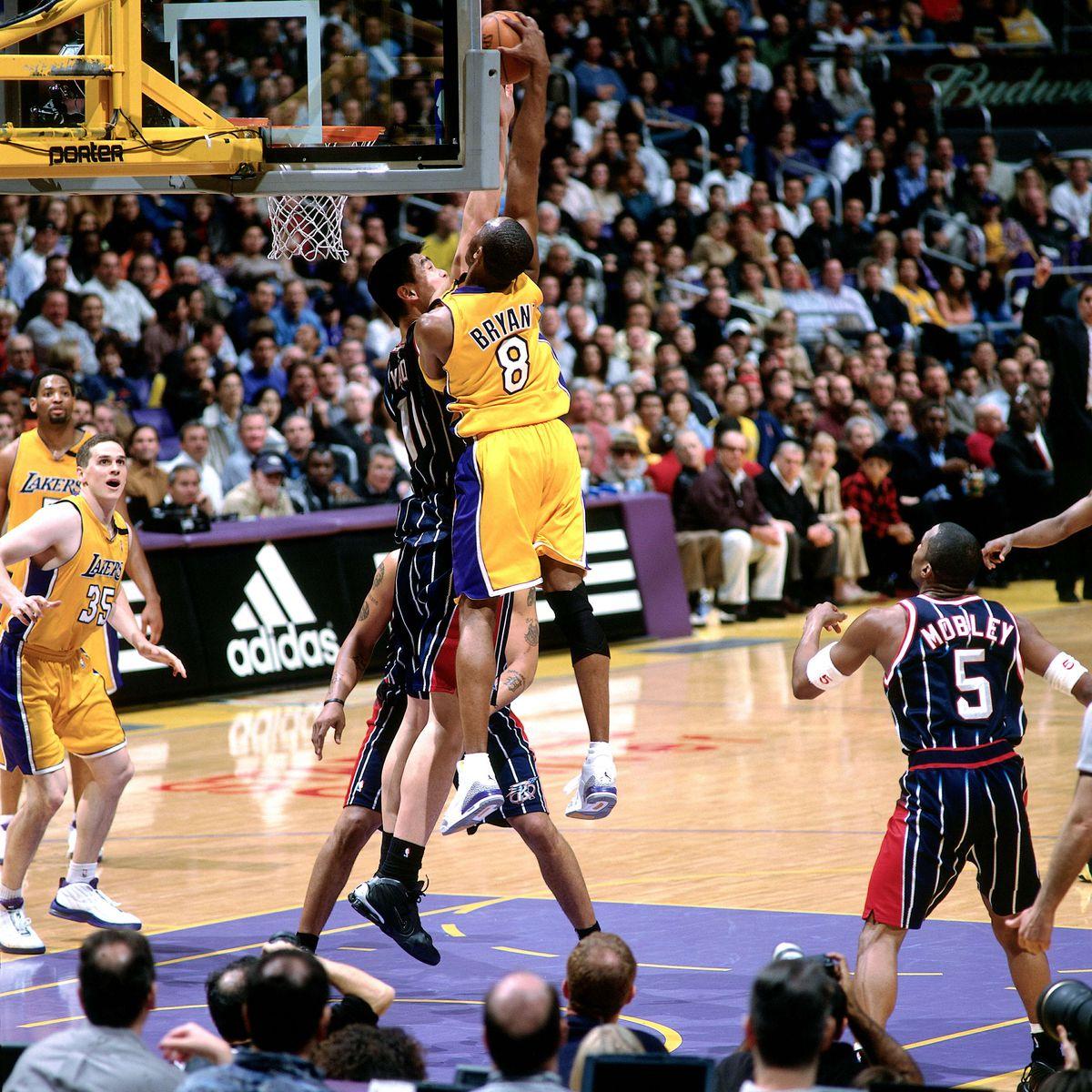 Kobe dunks over Yao