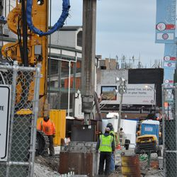 Final moments of the steel beam being pushed into the ground on the Clark Street side of the triangle lot