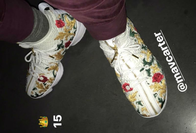 0f01afafe6e ... let alone James  own Nike line. The floral print accentuates Nike s new  Battle knit material the shoe is made of and the shoestrings come with  golden ...