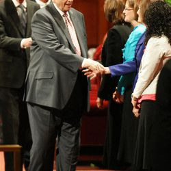 President Thomas S. Monson says goodbyes while leaving the General Relief Society Meeting at the Conference Center on Temple Square in Salt Lake City on Saturday, Sept. 29, 2012.