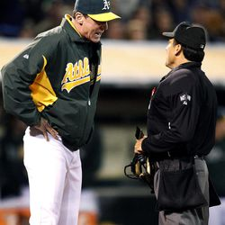 Oakland Athletics manager Bob Melvin, left, argues a call with home plate umpire Phil Cuzzi in the sixth inning against the Boston Red Sox in a baseball game Saturday,  Sept. 1, 2012 in Oakland, Calif.