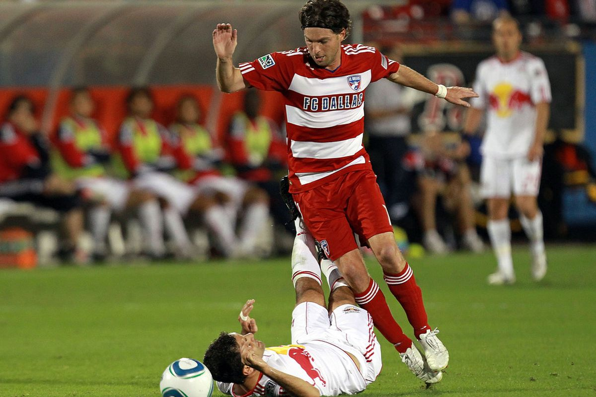FRISCO, TX - OCTOBER 26:  Rafa Marquez #4 of the New York Red Bulls is tripped by Ricardo Villar #11 of the FC Dallas at Pizza Hut Park during a wild card match on October 26, 2011 in Frisco, Texas.  (Photo by Ronald Martinez/Getty Images)