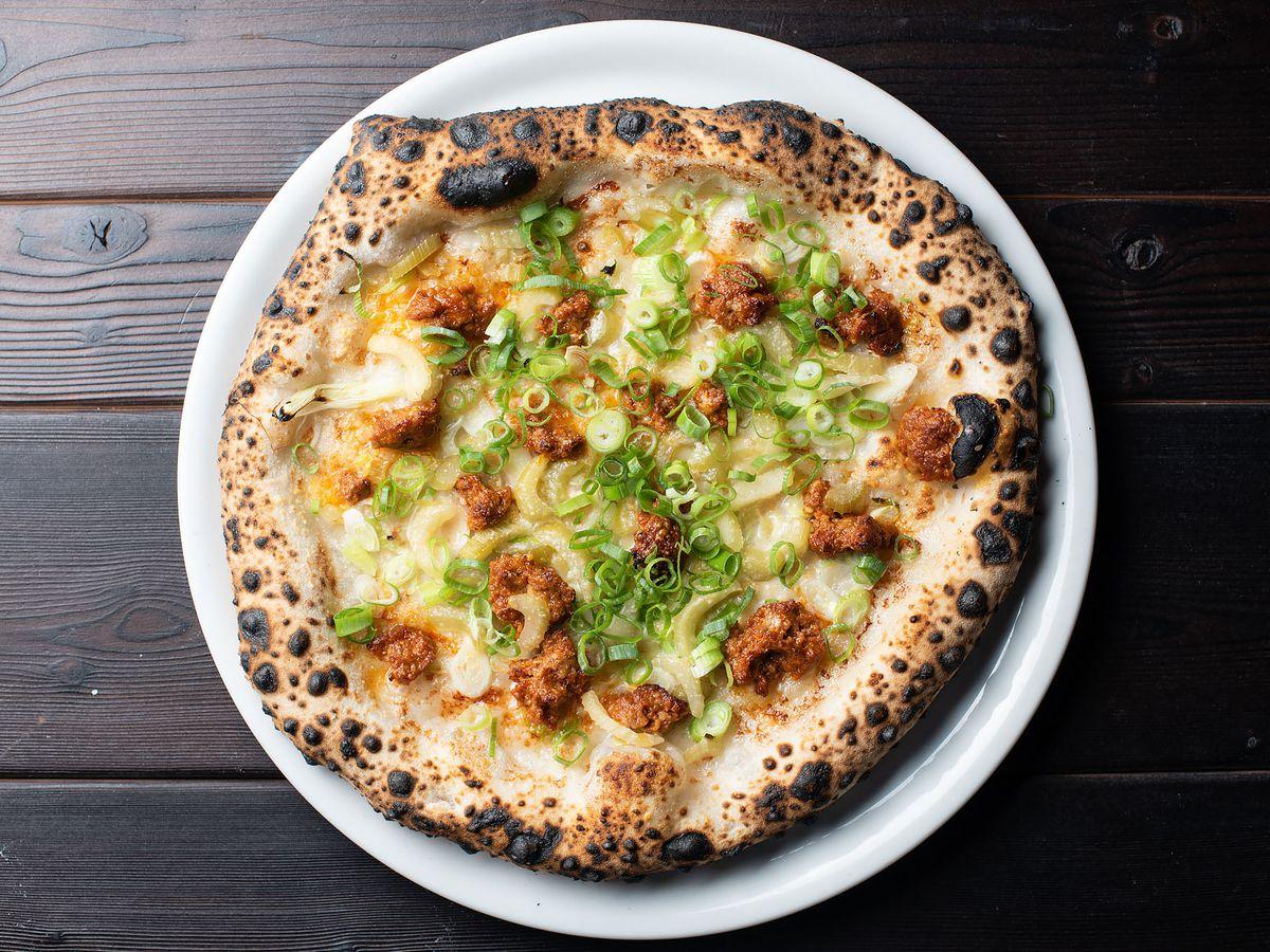 Ancora pizza with nduja, gorgonzola cream, green onion, and celery at Ronan