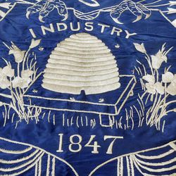 Close-up of part of the 1903 Utah State flag presented by The Utah State Society of the Daughters of the Revolution to Governor Heber M. Wells.