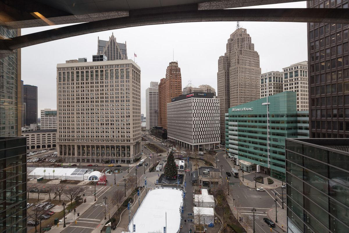 Looking out on Detroit from Dan Gilbert's 10th-floor office in the Compuware Building, which he finally acquired this fall. His holdings also include the tan building on the left, the white building in the center, the white building in the backgrou