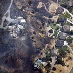 A burned home is seen at the mouth of Weber Canyon on Tuesday, Sept. 5, 2017, as a wildfire burns in the area.