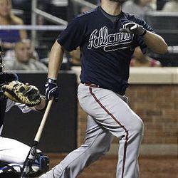 Atlanta Braves' Brian McCann follows through on a home run.
