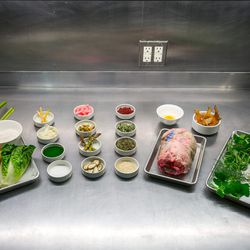 The ingredients: (left tray) Rhubarb, Yukon gold potato, little gem lettuce. Greek yogurt, flour. (Bowls at center, l-r from top): Pickled rhubarb, pickled red onions, dried sumac, egg, za'atar-spiced potato chips, pickled fennel, pickled green strawberry