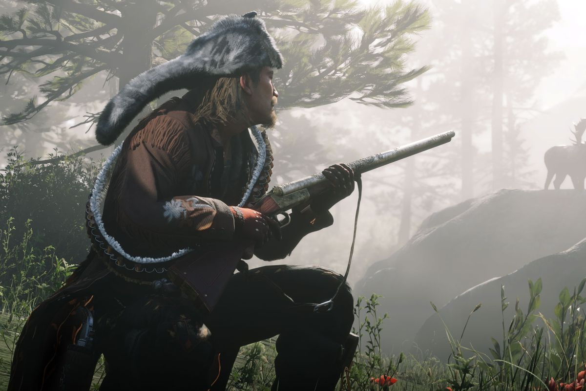 Guy with a rifle and a moose in a screenshot from Red Dead Online