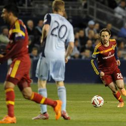 Real Salt Lake's Ned Grabavoy looks for an outlet to pass to during a game at Sporting Park in Kansas City, Kan., on Saturday, April 5, 2014.