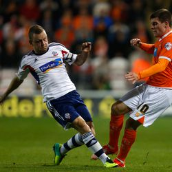 Bobby Grant (R) of Blackpool in action with Jay Spearing of Bolton during the Sky Bet Championship match between Blackpool and Bolton Wanderers at Bloomfield Road on October 01, 2013 in Blackpool, England. (Photo by Paul Thomas/Getty Images)