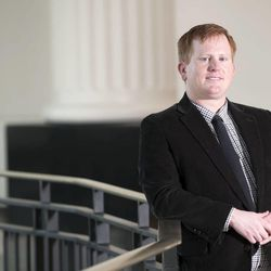 Jared Allebest stands inside the Matheson Courthouse in Salt Lake City on Wednesday, Dec. 11, 2013. Allebest is one of fewer than 200 deaf attorneys in the United States.