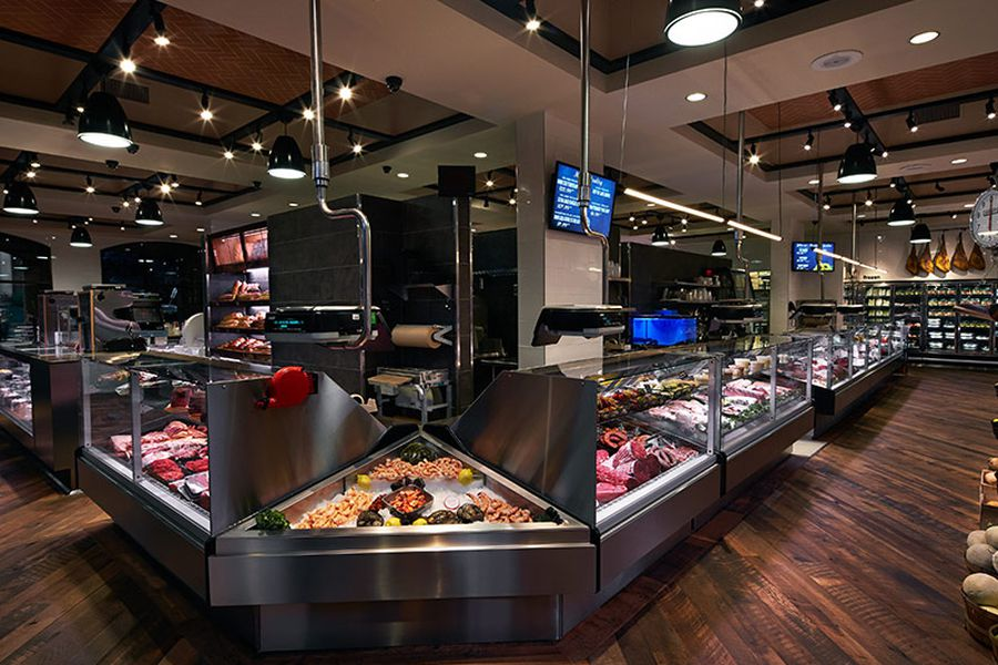 Wagshal's display case, with several meats showing behind glass