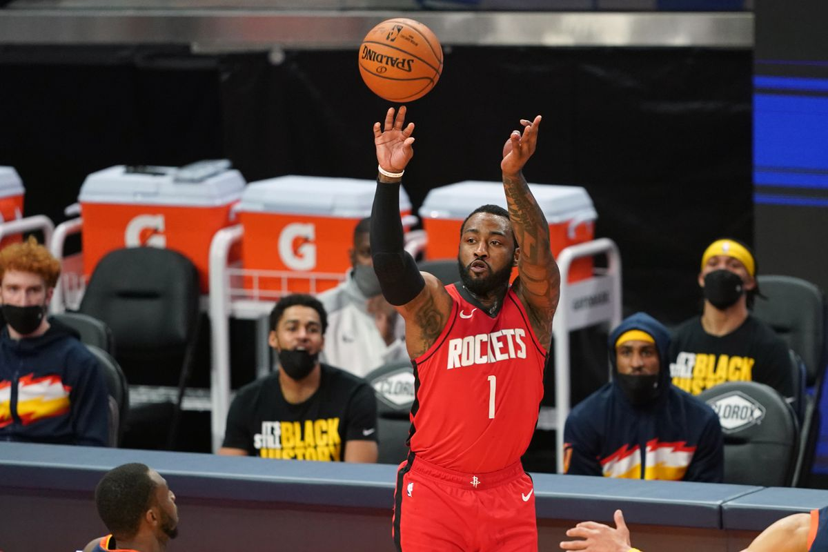 Houston Rockets guard John Wall shoots a three point basket during the third quarter against the Golden State Warriors at Chase Center.