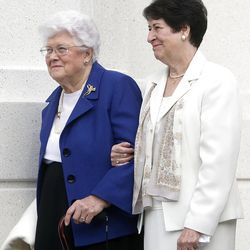 Sister Donna Packer, left, stands with Wendy Watson Nelson during the cornerstone ceremony. About 200 take part in the cornerstone ceremony at the Brigham City Temple prior to the dedication Sunday, Sept. 23, 2012.