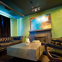 Cozy up in the deep leather couch in front of the fireplace