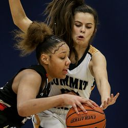 Judge Memorial's Teya Sidberry (32) drives into Summit Academy's Ella Christian (25) at Summit Academy in Bluffdale on Thursday, Jan. 9, 2020.