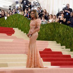 Beyoncé wears a latex-like gown by Givenchy.