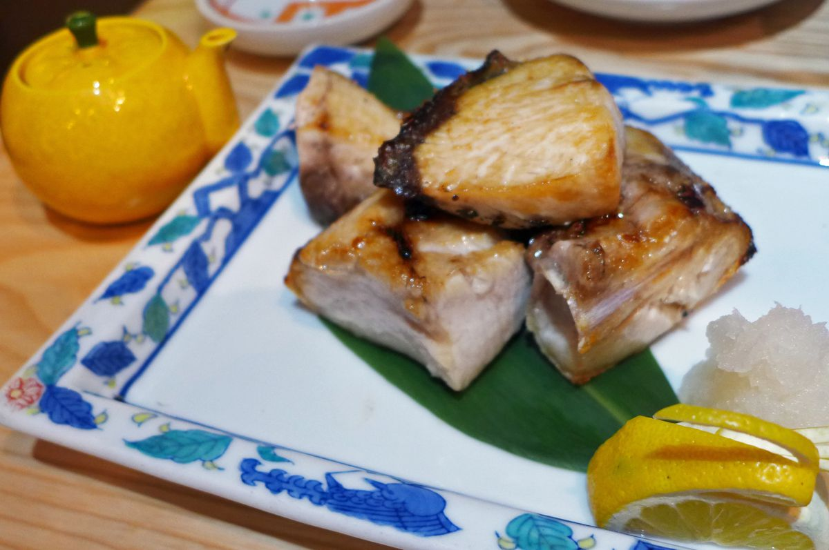 Chunks of glistening fish on a plate.